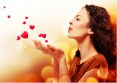 picture of wifes  - Beauty Young Woman Blowing Hearts from her Hands - JPG