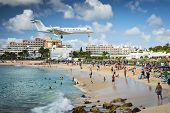 PHILIPSBURG, SINT MAARTEN - DECEMBER 30, 2013: A commercial jet approaches Princess Juliana airport
