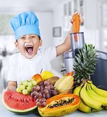 pic of fruit-juice  - Happy little chef is making healthy fruit juice at home - JPG