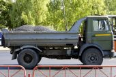 picture of oversize load  - The lorry loaded by asphalt costs on the new asphalted road - JPG