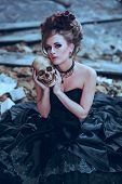 picture of gothic girl  - Mysterious woman dressed in gothic dress posing in ruined building - JPG