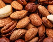 image of pecan nut  - Background texture of assorted mixed nuts including cashew nuts pecan nuts almonds - JPG