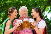 stock photo of lederhosen  - In Beer garden  - JPG