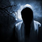 pic of dangerous  - Dangerous man hiding under the hood in the dark night forest - JPG