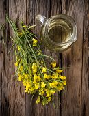 stock photo of cruciferous  - Rape flower on wooden table - JPG