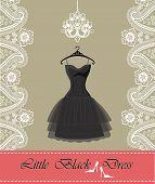 picture of little black dress  - Classic little black dress hanging on hanger  - JPG