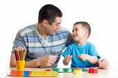 image of molding clay  - Father and child play with clay together - JPG