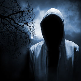 pic of hoods  - Dangerous man hiding under the hood in the dark night forest - JPG