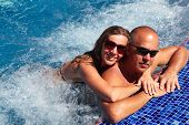 image of hot-tub  - Loving happy couple in hot - JPG