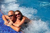 picture of hot-tub  - Loving happy couple in hot - JPG