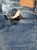 image of hot pants  - Close up of burning phone in jeans back pocket - JPG