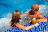 picture of hot-tub  - Couple with coconut drink relaxing in hot tub - JPG