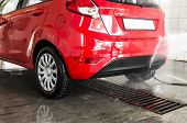 image of suds  - Red cars in a professional carwash station - JPG