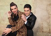 picture of lap  - Happy fashion couple sitting and smiling at the camera - JPG