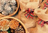image of gift basket  - Xmas gift and pine cone in basket decoration for christmas season present bag from burlap with amazing knot - JPG