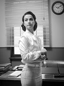 image of cuff  - Attractive confident business woman in the office adjusting shirt cuff - JPG