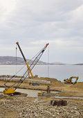 stock photo of samson  - crane working on the construction of the bay near the sea - JPG