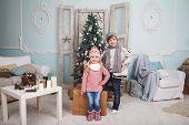 picture of mood  - Christmas mood childrens around the Christmas tree - JPG