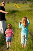 image of frisbee  - Father and his children play with frisbee - JPG