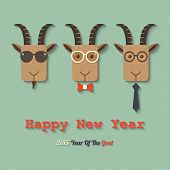 stock photo of goat horns  - three goats wearing glasses within 2015 year of the goat sign - JPG