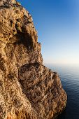 image of grotto  - high cliffs and sea Neptune Grotto in Sardinia Italy - JPG