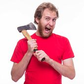 stock photo of ax  - Man tries to cut off his head with an ax - studio shoot
