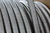 stock photo of coil  - Stainless steel corrugated Metal flexible hose coil - JPG