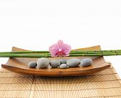 stock photo of bamboo leaves  - Pink orchid with bamboo grove and stones in bowl on mat texture   - JPG