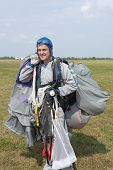 picture of parachute  - Landed on the airfield skydiver with an open parachute - JPG