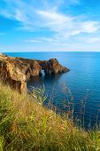stock photo of grotto  - Sea landscape with grotto in the rock - JPG