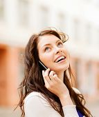 foto of people talking phone  - young woman talking on the phone outdoors - JPG