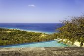 picture of infinity pool  - Empty Infinity Pool Overlooking Tropical Water Mustique Island - JPG