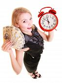 picture of time-saving  - Happy business woman holding red alarm clock and polish currency money banknote. Finance time for investment or savings. ** Note: Soft Focus at 100%, best at smaller sizes - JPG