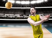 picture of volleyball  - Volleyball player on yellow uniform on volleyball court - JPG