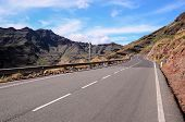 picture of canary  - Long Empty Desert Asphalt Road in Canary Islands Spain - JPG