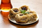 image of baklava  - Turkish arabic dessert - baklava with honey and walnut, pistachios nuts