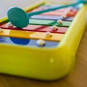 foto of musical scale  - A small xylophone for children in the scale of C. ** Note: Shallow depth of field - JPG