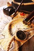foto of spyglass  - Marine still life spyglass and world map on wooden background - JPG