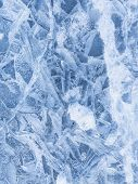 stock photo of ice crystal  - beautiful delicate patterns on the surface of the crystal clear blue ice on the lake in the winter in December before Christmas - JPG