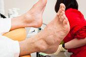 picture of chiropodist  - pedicure male feet in a modern beauty salon - JPG