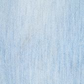 image of denim jeans  - Jeans denim dirlty light blue cloth fragment as a background texture composition - JPG