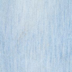 stock photo of denim jeans  - Jeans denim dirlty light blue cloth fragment as a background texture composition - JPG
