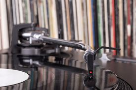 picture of disc jockey  - Dj needle stylus on spinning record vinyl background - JPG