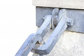 picture of shackles  - Isolated blue color chain shackle attached to a stone pilar over a white background - JPG
