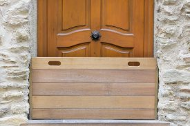 image of safety barrier  - Wooden barrier door used as a protection from floods and snow - JPG