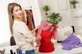 picture of dress mannequin  - Young woman fashion designer creates a dress on mannequin - JPG