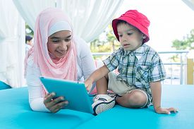 pic of muslim  - Happy Muslim young woman and little boy on summer vacation - JPG