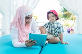 foto of muslim  - Happy Muslim young woman and little boy on summer vacation - JPG