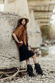 Постер, плакат: Beautiful Stylish Boho Woman With Hat Fringe Poncho And Boots Girl In Gypsy Hippie Look Young Trav