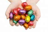 stock photo of easter-eggs  - A child holding out a handful of colourful Easter Eggs - JPG